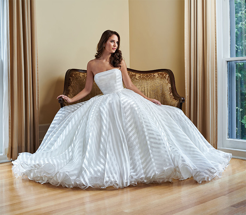 A line wedding dress with chapel length train