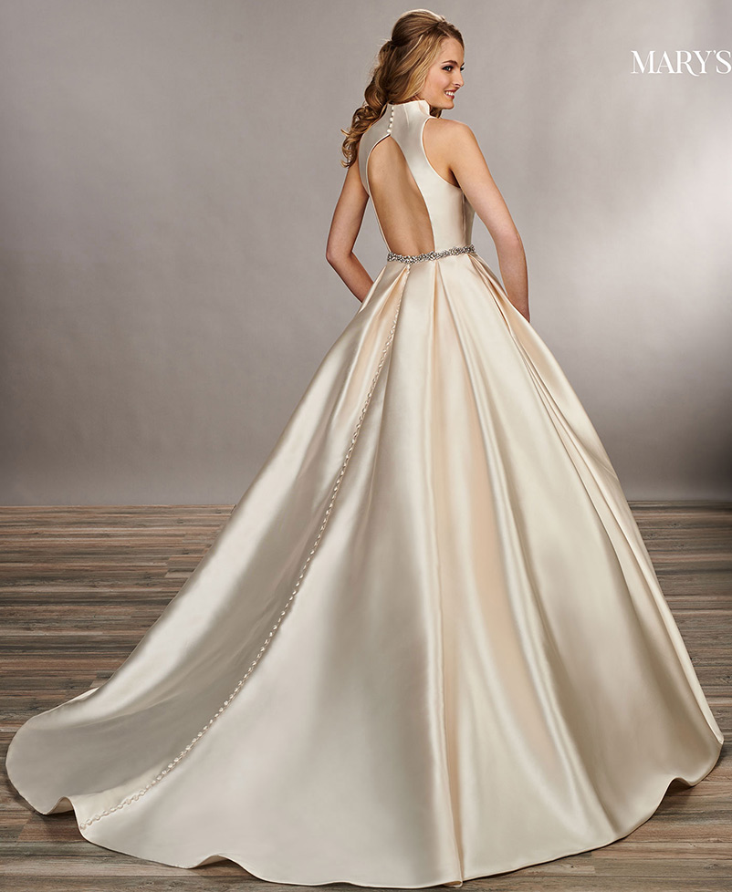 a line wedding dress with a chapel length train